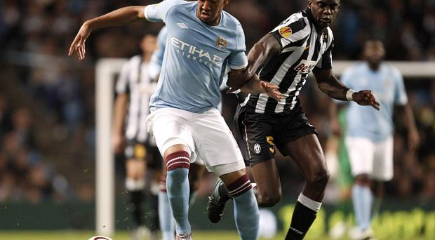 Juventus's Mohamed Sissoko (right) and Manchester City's Jerome Boateng battle for the ball during the UEFA Europa League match at the City of Manchester Stadium