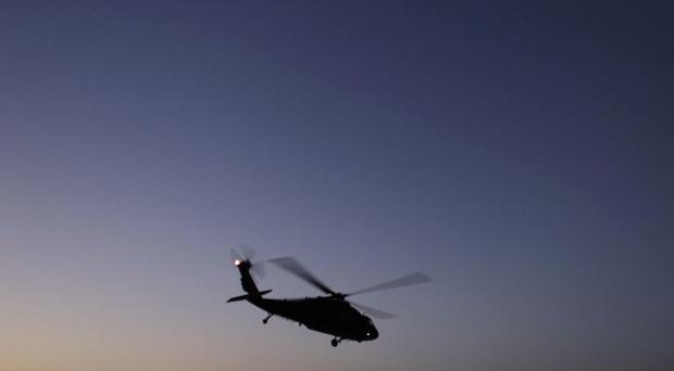 Pakistan has blocked a vital supply line after an alleged cross-border helicopter strike by Nato forces