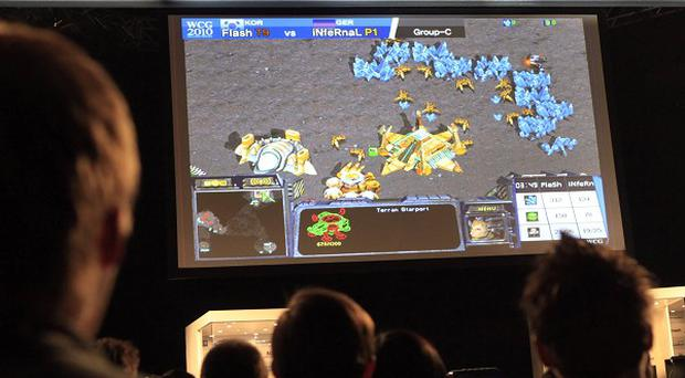 Gamers watch a StarCraft match at the 10th annual World Cyber Games in Los Angeles (AP)