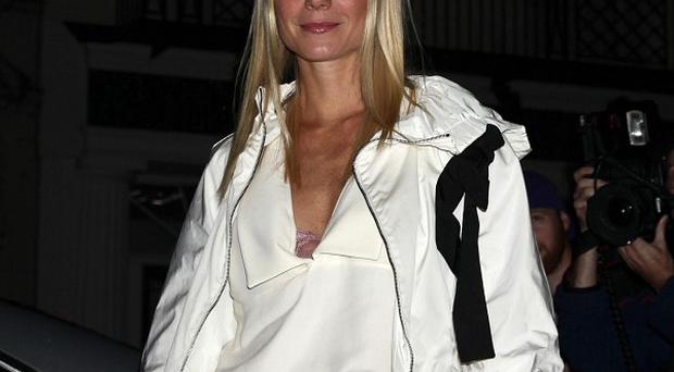 Gwyneth Paltrow has been working on a song for her latest film with husband Chris Martin