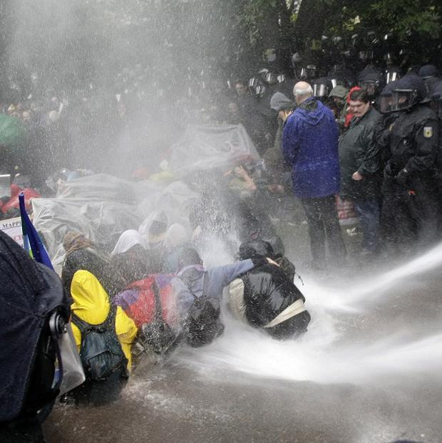 Police use water cannons at a demonstration to protest against a disputed railway project in Stuttgart, Germany (AP)