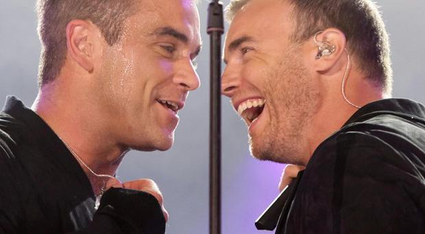 Robbie Williams and Gary Barlow put aside their differences to reform the original Take That line-up
