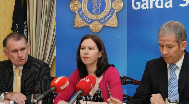 Detective Supt Christy Mangan (left), Lorna O'Mahony and Detective Inspector Ashley O'Sullivan appeal to catch the armed gang who murdered Ms O'Mahony's father Dessie Fox 20 years ago