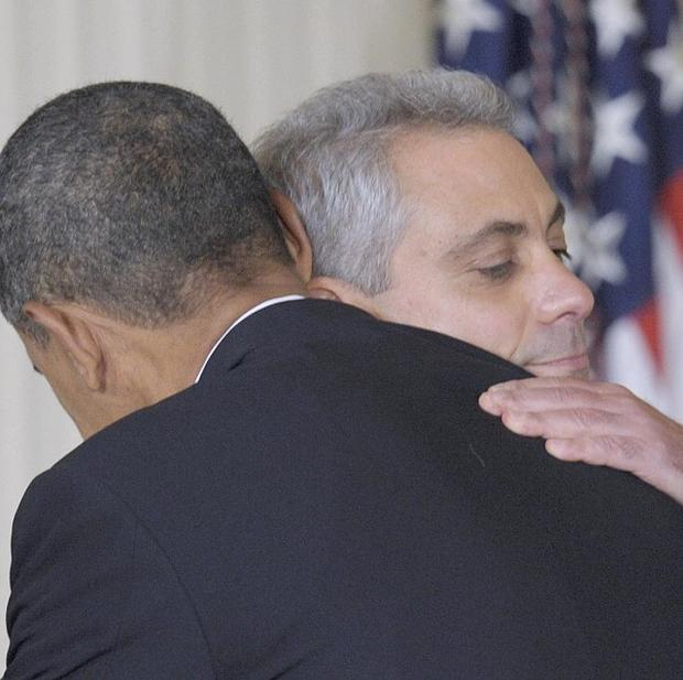 President Barack Obama gives outgoing White House Chief of Staff Rahm Emanuel a hug (AP)