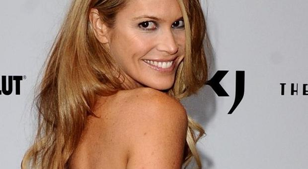 Elle Macpherson has admitted she fancies Simon Cowell