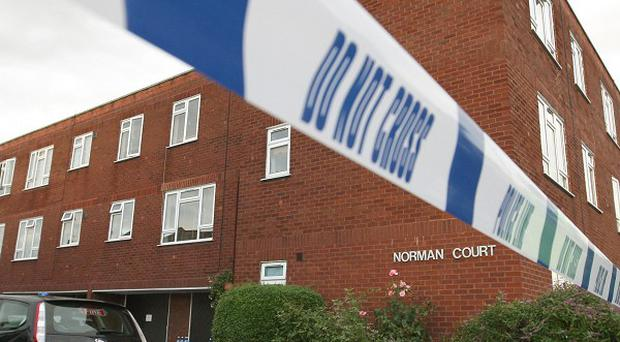 Norman Court in Putney, where the bodies of two women were discovered inside a flat