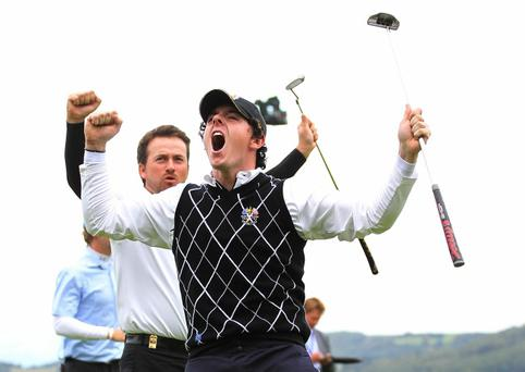 Rory McIlroy (R) of Europe celebrates holing a putt with team mate Graeme McDowell to wiin their match on the 17th green during the Fourball & Foursome Matches during the 2010 Ryder Cup at the Celtic Manor Resort on October 3, 2010 in Newport, Wales
