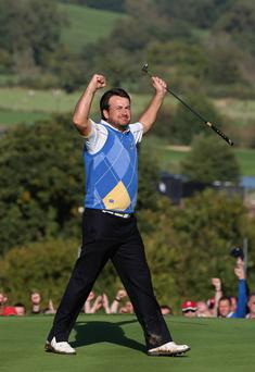 Graeme McDowell of Europe celebrates his 3&1 win to secure victory for the European team on the 17th green in the singles matches during the 2010 Ryder Cup at the Celtic Manor Resort on October 4, 2010 in Newport, Wales