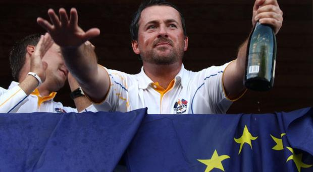 Europe's Graeme McDowell salutes the crowd from the balcony after Europe won the Ryder Cup at Celtic Manor, Newport