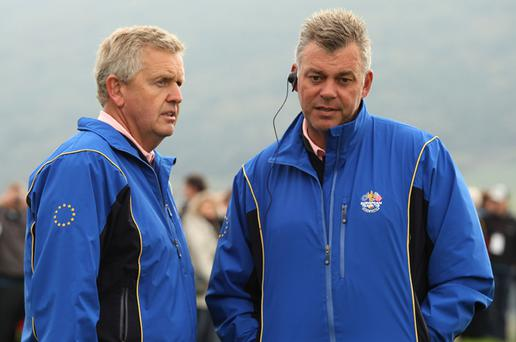 Ryder Cup Europe Team Captain Colin Montgomerie (L) chats with Vice Captain Darren Clarke. Clarke has said he does not want to be captain in Chicago in two years time