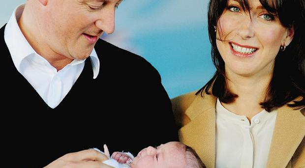 Prime Minister David Cameron with his baby girl Florence and wife Samantha
