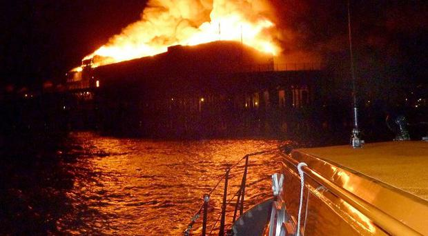 Hastings Pier on fire as seen from an RNLI boat