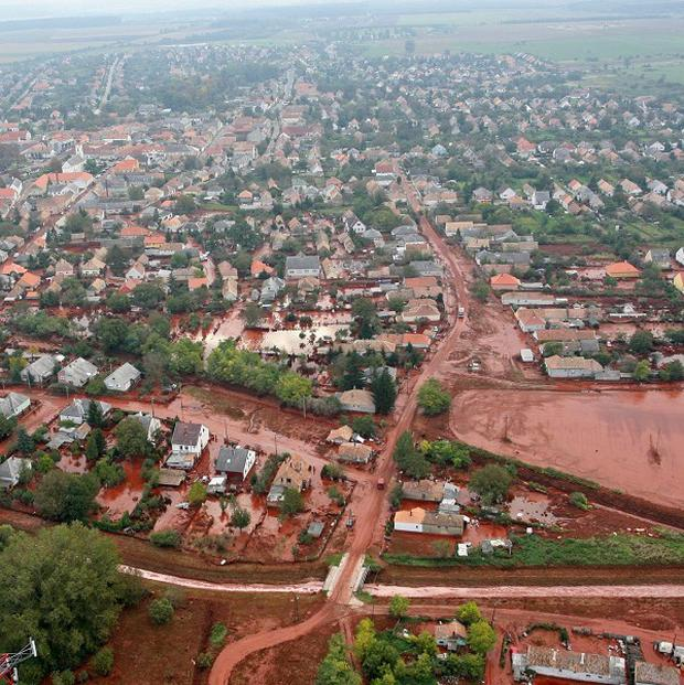 An aerial view of the red mud covering streets and neighborhood of Kolontar in Hungary. (AP)