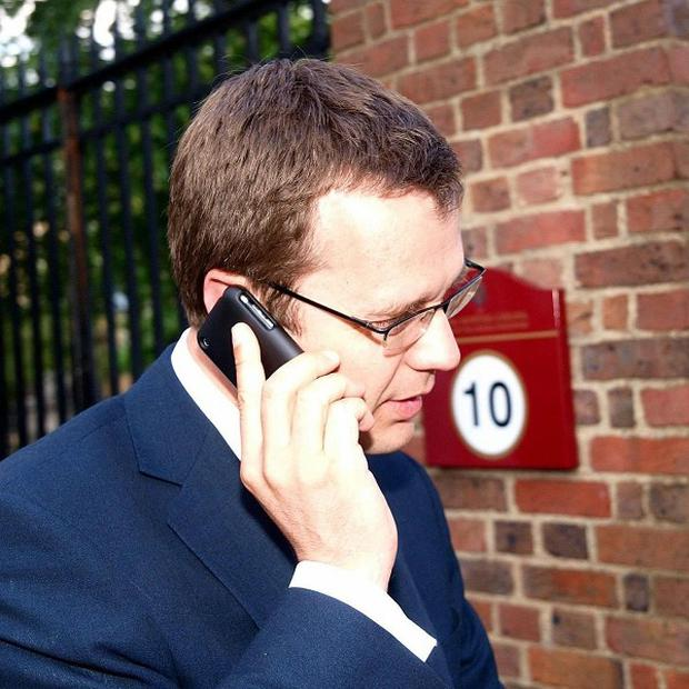 David Cameron has defended his Director of Communications Andy Coulson