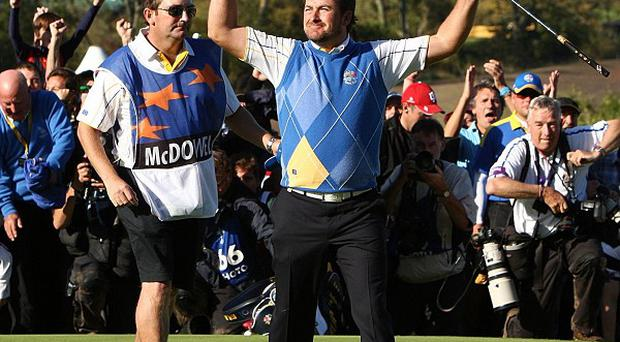 Europe's Graeme McDowell celebrates after winning the Ryder Cup