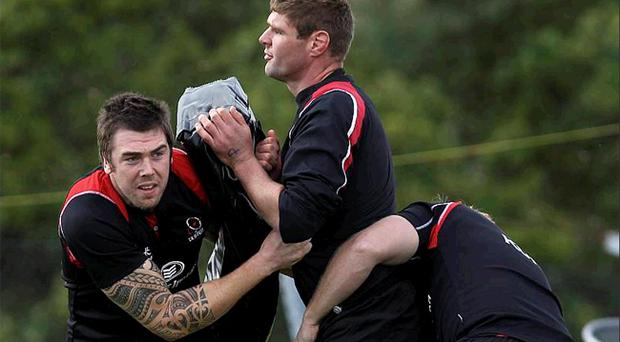 Ulster's South African lock Johann Muller (centre) cannot wait to sample his first taste of Heineken Cup action