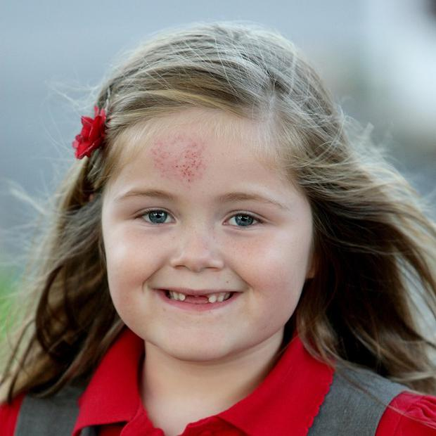 Six-year-old Niamh Riley smiles after she sent her tooth fairy money to Prime Minister David Cameron