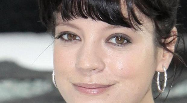 Singer Lily Allen accepted damages at the High Court in London