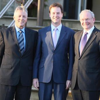 Deputy PM Nick Clegg is welcomed to Stormont Castle, Belfast, by Peter Robinson and Martin McGuinness