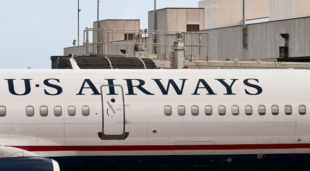 Two US Airways workers loading a Bermuda-bound plane grew suspicious of the behaviour of another baggage handler
