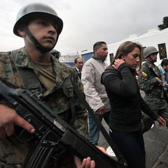 A court has issued an order authorising the jailing of 12 police officers and a police colone following an uprisingl in Ecuador (AP)