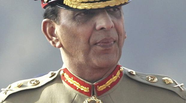 Pakistan's army chief Ashfaq Parvez Kayani ordered an inquiry into video clips that appear to show men in soldiers' uniforms killing blindfolded detainees (AP)