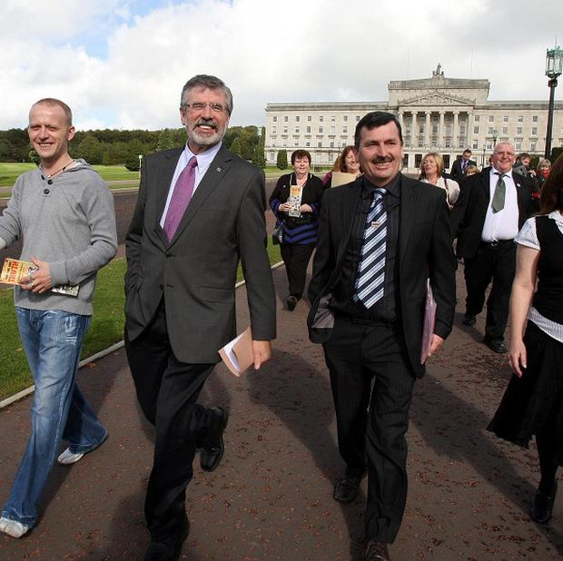Sinn Fein President Gerry Adams with family members of those killed by Paratroopers arrive at Stormont for talks