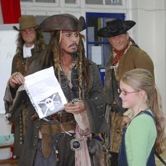 Johnny Depp holds a letter from Bea Delap inviting him to attend her school assembly (AP Photo/Meridian School, HO)