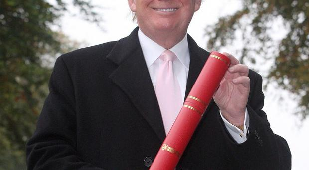 Donald Trump is presented with the honorary award of Doctor of Business Administration at Robert Gordon University