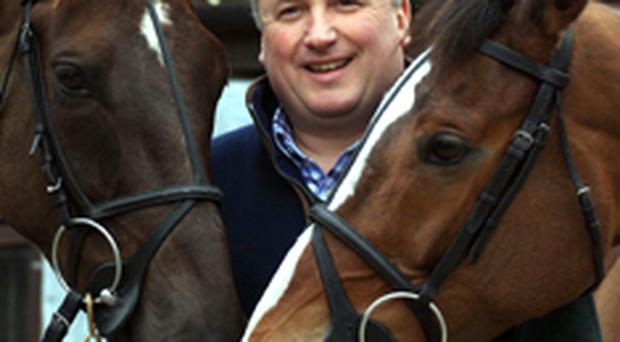 Trainer Paul Nicholls with Kauto Star (right) and Denman at his stables at Ditcheat, near Wincanton
