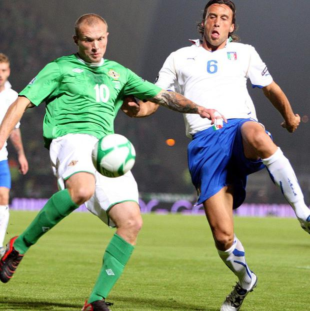 Warren Feeney and Stefano Mauri (right)