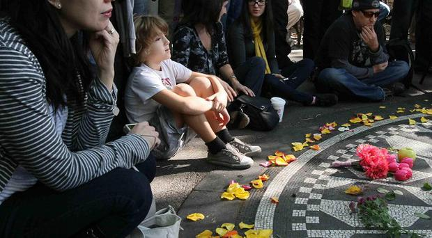 Fans gathered around the Imagine mosaic in New York's Central Park to remember John Lennon (AP)