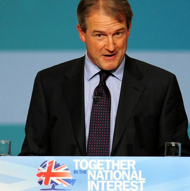 Northern Ireland Secretary Owen Paterson told the Conservative Party Conference that violent dissidents will be pursued