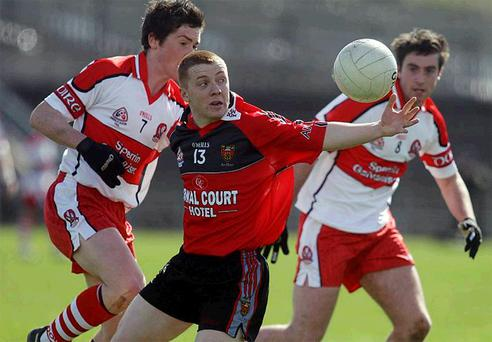 Ciaran Brannigan (centre) scored two goals to help Bryansford beat Kilcoo yesterday