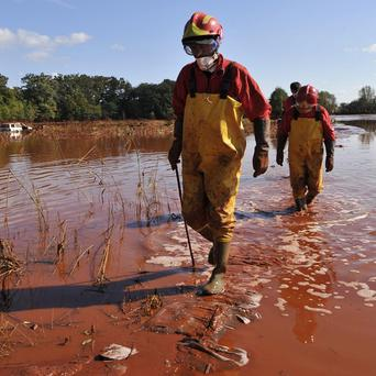 A rescue team searches for missing people in toxic mud in Hungary (AP)