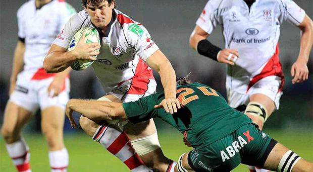 Robbie Diack, Ulster's man of the match in their Heineken Cup win over Aironi on Friday night tries to evade the challenge of Nicola Cattina