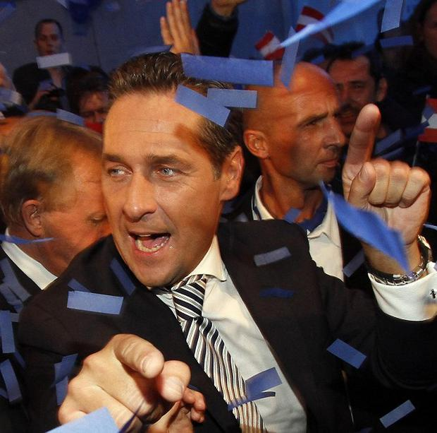 Top candidate of the right-wing Freedom Party for the local elections in Vienna, Heinz Christian Strache celebrates (AP)