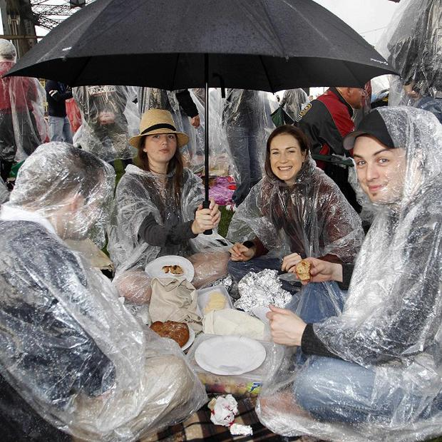 People brave the rain during Breakfast on the Bridge in Sydney, Australia (AP)