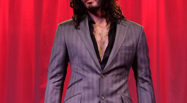 A waxwork of Russell Brand has been unveiled at Madame Tussauds in London