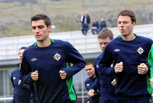 Northern Ireland's Aaron Hughes and Jonny Evans go through their paces during training in Torshavn yesterday