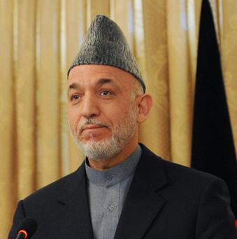 Hamid Karzai confirmed that his government has been in informal talks with the Taliban on securing peace