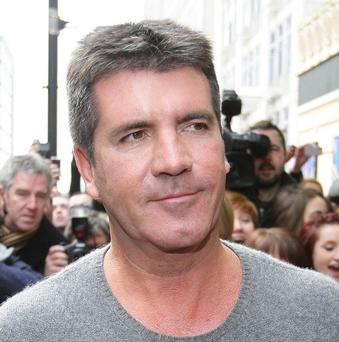 Simon Cowell topped a poll of leading figures who women secretly fancy