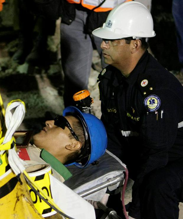 Carlos Mamani, 23, is stretchered off as he becomes the fourth miner to exit the rescue capsule, on October 13, 2010 at the San Jose mine