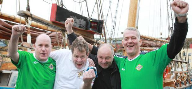 Northern Ireland fans Jim Rainey(left) and Andrew Brown (right) with German fans Rolf Walter and Falk Maebert who travelled from Berlin by car and Ferry to support Northern Ireland against the Faroe Islands