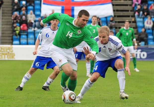 Faroe Islands v Northern Ireland:.Northern Ireland's David Healy with Faroe Islands Johan T Davidsen