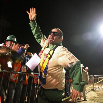 Miner Mario Sepulveda celebrates after being rescued from the collapsed mine in Chile (AP)