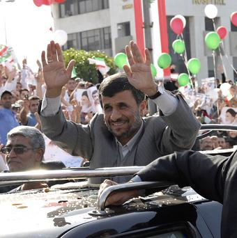 Iranian president Mahmoud Ahmadinejad waves to the crowds in Beirut as he arrives for his first state visit (AP)
