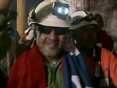 Luis Urzua, center, the 33rd and final miner to be rescued from the San Jose Mine near Copiapo, Chile