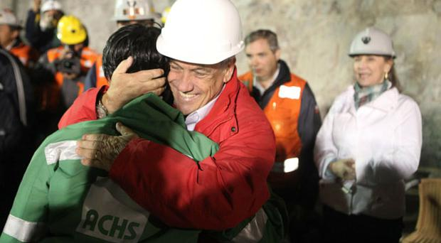 SAN JOSE MINE, CHILE - OCTOBER 13: (NO SALES, NO ARCHIVE) In this handout from the Chilean government, Ariel Ticona, the 32nd miner to be rescued, is hugged by Chile's president Sebastian Pinera on October 13, 2010 at the San Jose mine near Copiapo, Chile. The rescue operation has begun bringing up the 33 miners, 69 days after the August 5, 2010 collapse that trapped them half a mile underground. (Photo by Hugo Infante/Chilean Government via Getty Images)