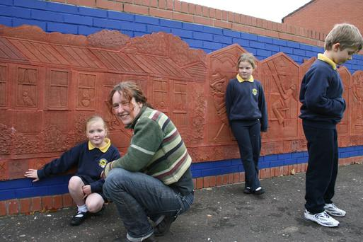 Local school children who worked with the artist Eleanor Wheeler to create an historic timeline of their area.